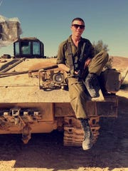 Silas Gelman, a 2016 Ravenwood High School graduate, seen sitting on an Israeli Defense Forces armored personnel carrier.