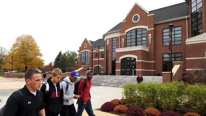 Students walk past the Rasmussen Center on the Grand View University campus in Des Moines in 2013.