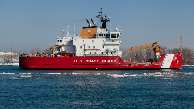 U.S. Coast Guard cutter Mackinaw travels down the St. Clair River Friday in Port Huron. A group of Harsens Island resdents is protesting ice breaking efforts this weekend in the St. Clair River's North Channel.