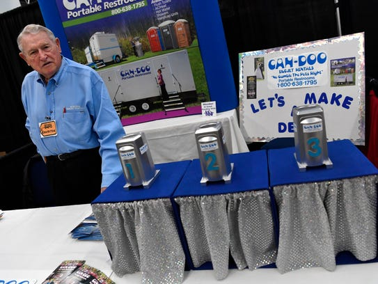 Lou Paulsen of Can-Doo Portable Restrooms at his Business EXPO booth Wednesday at the Abilene Convention Center.