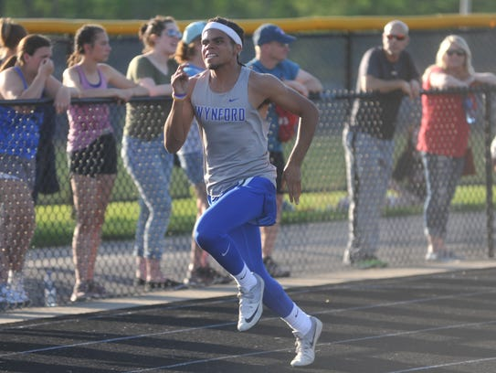 Wynford's Alizhah Watson races in the 400 dash at the