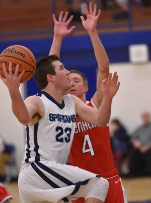 Devin Dunn (23) drives to the goal, guarded by Cal Fournier (4).