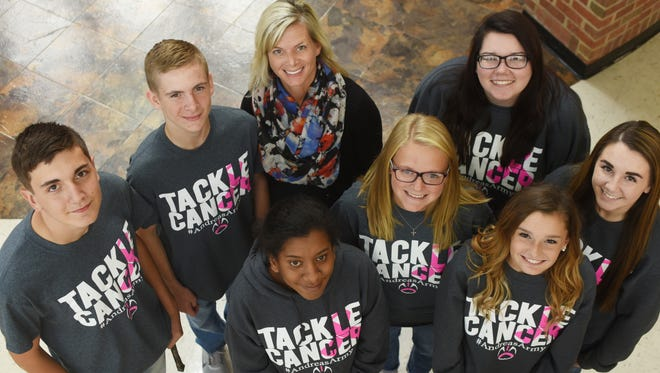 Andrea Lane, center top, an instructional aide at Maysville High School, was diagnosed with breast cancer in July. Students at the school rallied to her side, selling hundreds of T-shirts, sweatshirts and bracelets with Tackle Cancer, #andreasarmy on them.