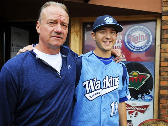 Tom Frericks and his son T.J. stand outside of Tom's