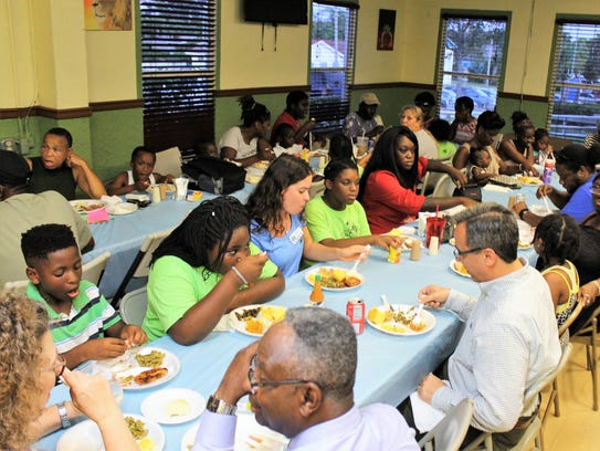 More than 100 guests enjoy a southern feast of chicken,