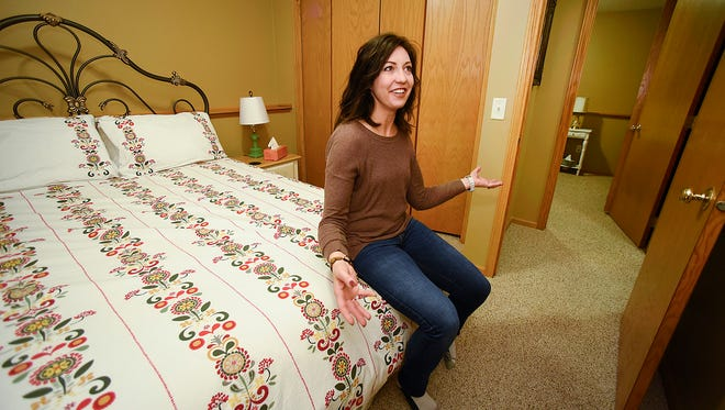 Julie Meyer, Sartell, sits in one of the bedrooms that she rents to guests through Airbnb, in a photo taken Friday, Dec. 2. Sartell and area cities are considering ordinances on short-term rentals like Airbnb.