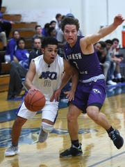 Spanish Springs' DJ Panfili pressures McQueen's JD kolb as he drives to the basket in the first half of Tuesday's game at McQueen.