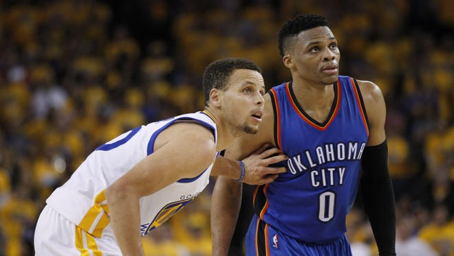 Oklahoma City Thunder guard Russell Westbrook (0) is defended by Golden State Warriors guard Stephen Curry (30) in the fourth quarter in game five of the Western conference finals of the NBA Playoffs at Oracle Arena.