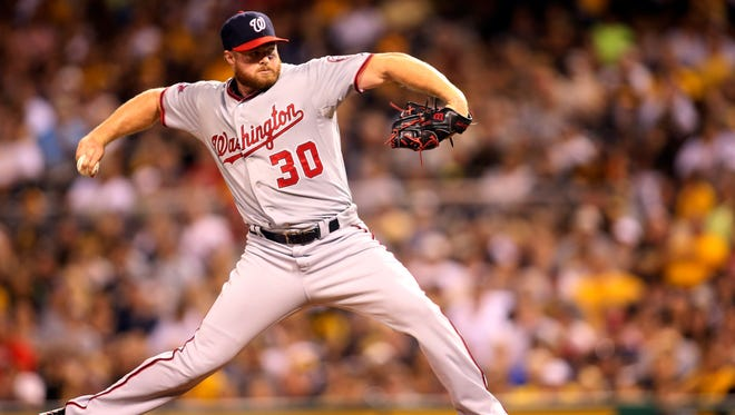 Washington Nationals relief pitcher Aaron Barrett (30) pitches against the Pittsburgh Pirates during the seventh inning at PNC Park. The Pirates won 7-5.