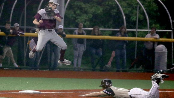 Mario Feliciano of Clarkstown South was safe at third