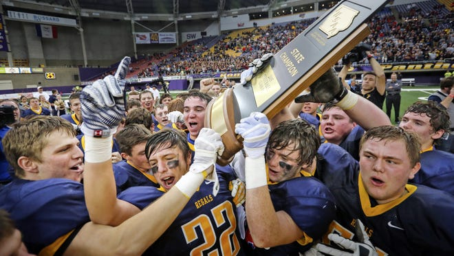 Iowa City Regina celebrates after winning the Class 1A championship game against Western Christian (Hull) on Monday, Nov. 23, 2015.