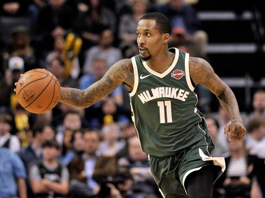 Milwaukee Bucks guard Brandon Jennings (11) brings the ball upcourt in the first half of an NBA basketball game against the Memphis Grizzlies, Monday, March 12, 2018, in Memphis, Tenn. (AP Photo/Brandon Dill) ORG XMIT: TNBD108