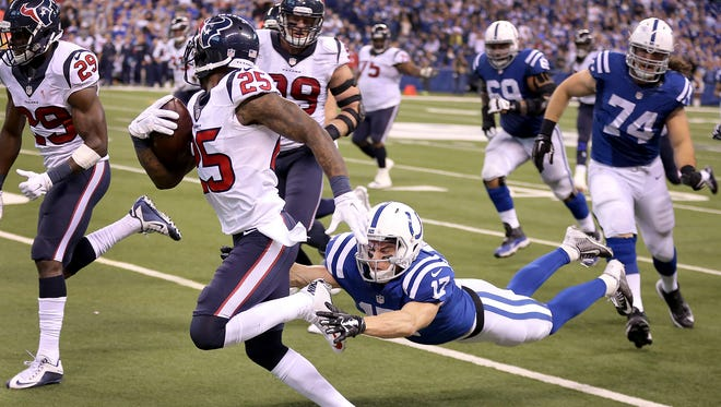 After fumbling the football, Indianapolis Colts wide receiver Griff Whalen (17) chases down Houston Texans cornerback Kareem Jackson (25) to tackle him in the fourth quarter. The Indianapolis Colts play the Houston Texans Sunday, December 20, 2015, afternoon at Lucas Oil Stadium.
