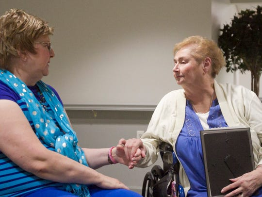 "Newly acquainted half-sisters Jane Logston, left, and Donna Collins get to know one another after meeting in July 2017 for the first time. Collins was adopted as an infant and the two met after an Ancestry DNA test revealed they were a ""close match."""
