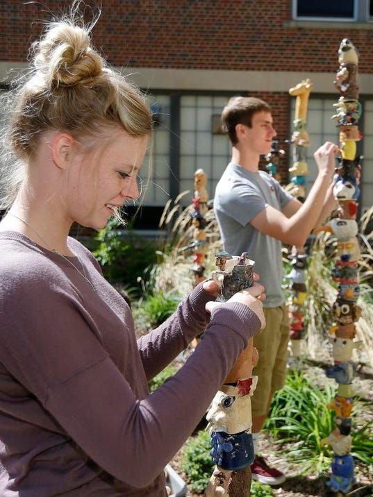 Art students create totem poles for GFH garden