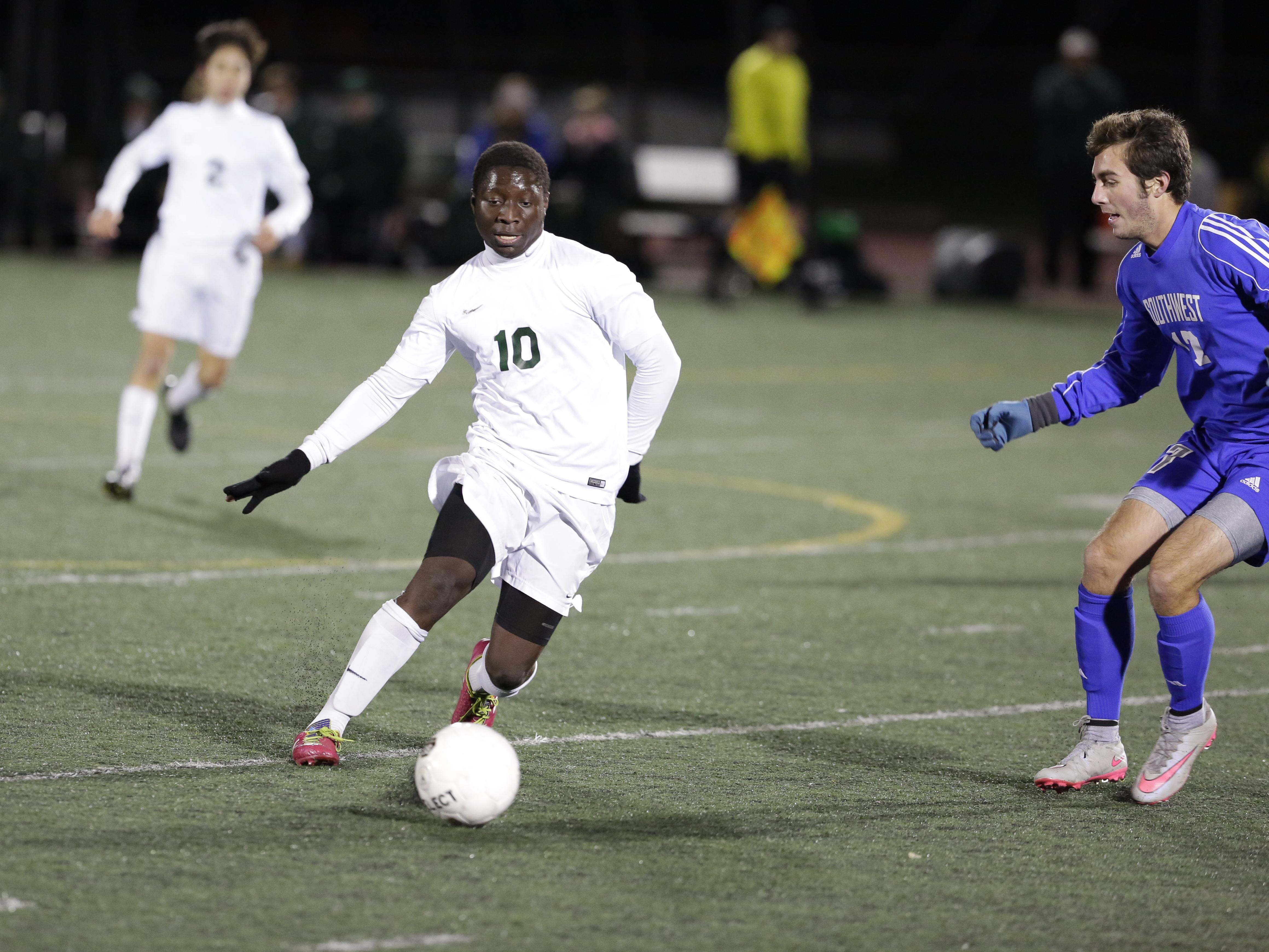 Oshkosh North's Ebrima Colley dribbles the the ball upfield during Thursssday's WIAA Division 2 sectional semifinal against Green Bay Southwest at J. J. Keller Field at Titan Stadium.