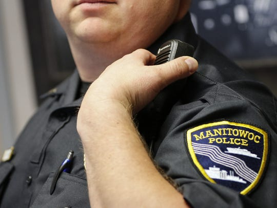 Detective Adam Sohlden from the Manitowoc Police Department will take part in a discussion on the drug epidemic in Manitowoc at the Manitowoc Public Library Monday at 6 p.m. In the photo, Manitowoc police officer Lt. Matt Wallander demonstrates the new radio May 19, 2017, in Manitowoc, Wis. Josh Clark/USA TODAY NETWORK-Wisconsin