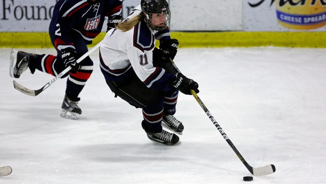 Brianna Ault of the Fox Cities Stars chases Natalie West of Appleton United during an Eastern Shores Conference girls' hockey game at the Appleton Family Ice Center on Jan. 22.