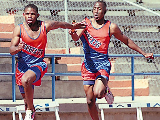 San Angelo Central runner Sam Singleton takes the baton during a preliminary heat of the 4x100-meter relay at the San Angelo Relays in 1997.