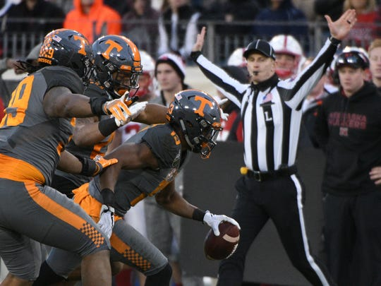 Tennessee cornerback Malik Foreman celebrates with teammates after making a play during the second half of Friday's game.