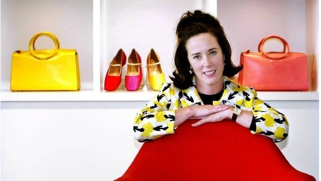Kate Spade, a well-known designer and businesswoman, poses with her handbags and shoes.