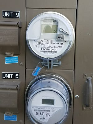 New smart meter, top, will replace older meters to enhance efficiency in usage monitoring.