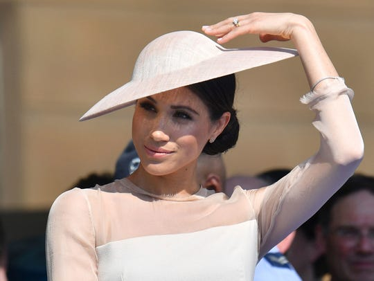 Duchess Meghan of Sussex at a garden party at Buckingham