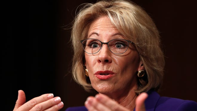 FILE - In this Jan. 17, 2017, file photo, Education Secretary-nominee Betsy DeVos testifies on Capitol Hill in Washington. Republicans are muscling more of President Donald Trump's Cabinet nominees to the cusp of Senate confirmation over Democratic objections, with committees poised to advance his picks to head agencies in the thick of partisan battles over health care, legal protections, education and the economy. (AP Photo/Carolyn Kaster, File)