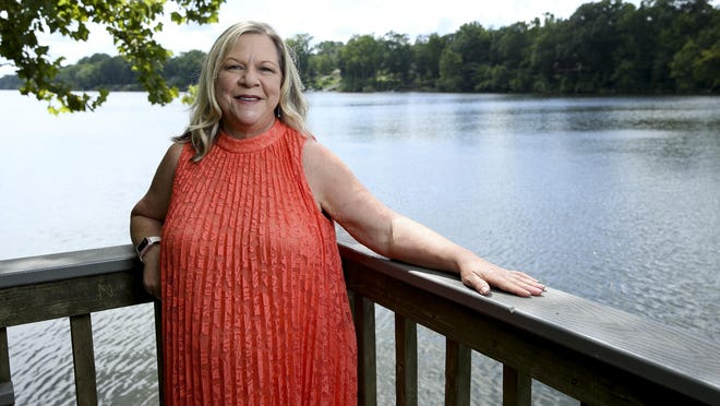 Lynda Smith poses for a photo at the fishing pier on the Black Warrior River at Manderson Landing Tuesday, July 28, 2020.