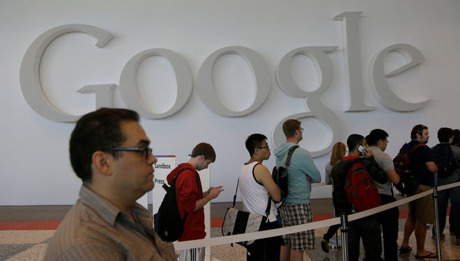 People line up for registration at Moscone Center for the Google I/O 2013 in San Francisco in May.