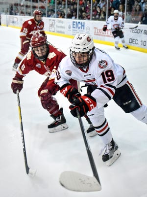 St. Cloud State's Mikey Eyssimont gets past Matt VanVoorhis of Denver during the first period of the Saturday, Jan. 21, game at the Herb Brooks National Hockey Center in St. Cloud.