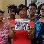 Members of a mostly black book club say they believe they were kicked off the train because of their race.