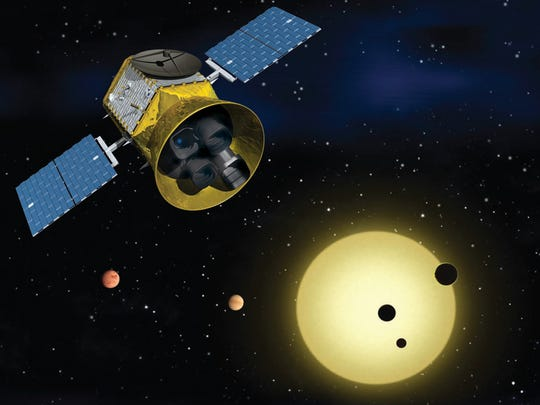 An illustration of the TESS orbiting telescope checking for alien planets. The instrument may launch as soon as April 16.