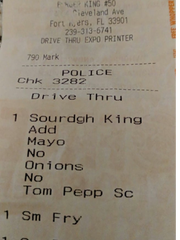 Image of a receipt that a Fort Myers police officer said he received along with a burger he claimed had dirt on it.
