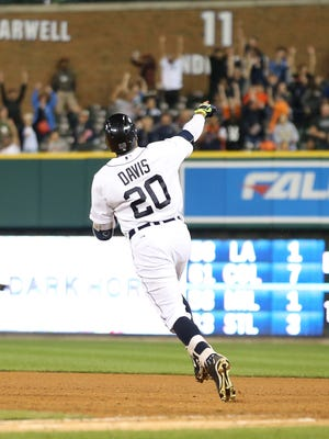 Tigers leftfielder Rajai Davis celebrates after hitting a two-run home run to rightfield during the eighth inning of the Tigers' 6-4 win Friday at Comerica Park.