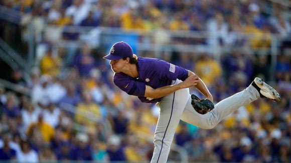 LSU pitcher Aaron Nola (10) pitches in the first  inning of an NCAA college baseball regional tournament game against Houston in Baton Rouge, La., Saturday, May 31, 2014. (AP Photo/Gerald Herbert)
