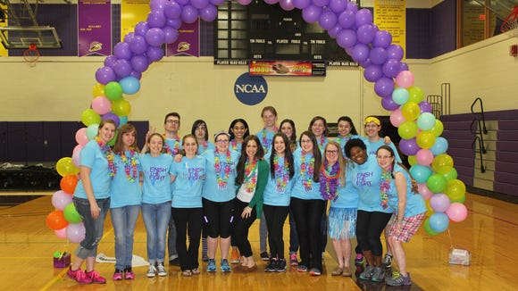 The organizing committee for Nazareth College's first Relay for Life event poses for a photo.