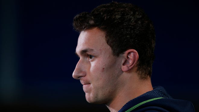 Texas A&M Aggies quarterback Johnny Manziel speaks to the media in a press conference during the 2014 NFL Combine at Lucas Oil Stadium.