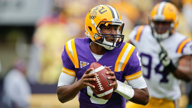 LSU quarterback Brandon Harris (6) looks downfield Saturday during the 2014 spring game at Tiger Stadium.