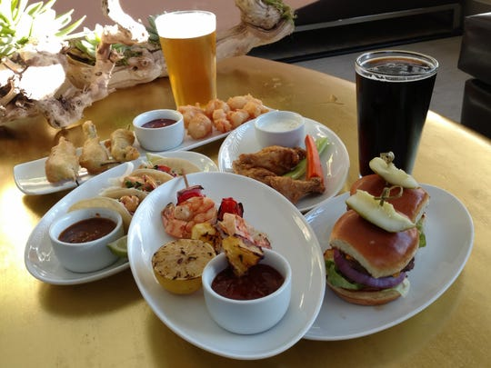 The variety of menu items includes shrimp skewers, sliders, mahi mahi street tacos, chicken wings, shisito peppers, and Babe's Black Fin lager.