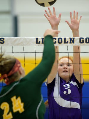 Hagerstown's Aimee Hoodlebrink jumps against Northeastern's Mariah Clear Thursday, Oct. 20, 2016 during a volleyball sectional match at Lincoln High School in Cambridge City.