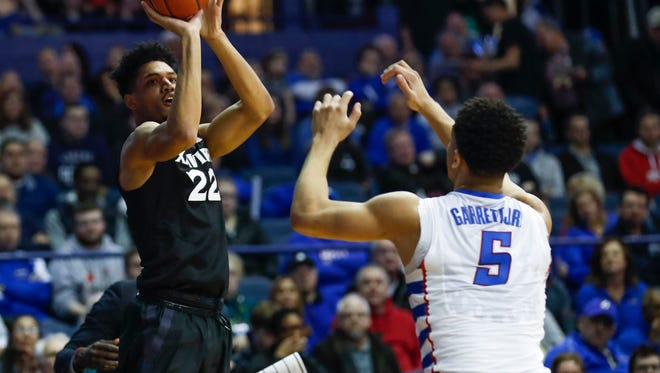 Mar 4, 2017; Rosemont, IL, USA; Xavier Musketeers forward Kaiser Gates (22) shoots against DePaul Blue Demons guard Billy Garrett Jr. (5) during the first half at Allstate Arena. Mandatory Credit: Kamil Krzaczynski-USA TODAY Sports