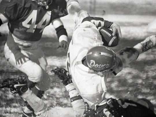 Lancaster defenders tackle a York County All-Star in the first War of the Roses in 1989. Dover had three players - quarterback Mike Wilt, tight end Ron Sanger and running back Ryan Reinert - participate in the game.