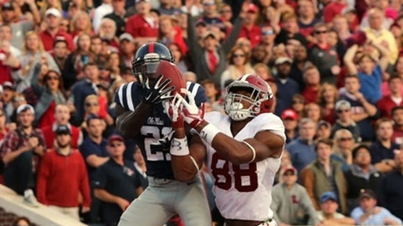 OXFORD, MS - OCTOBER 4: Senquez Golson #21 of the Ole Miss Rebels intercepts a pass attempt in the endzone against O.J. Howard #88 of the Alabama Crimson Tide on OCTOBER 4, 2014 at Vaught-Hemingway Stadium in Oxford, Mississippi. Mississippi beat Alabama 23-17. (Photo by Joe Murphy/Getty Images)