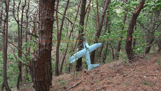 In this Friday, June 9, 2017 photo provided by South Korean Defense Ministry on Tuesday, June 13, 2017, a suspected North Korean drone is seen in a mountain in Inje, South Korea.