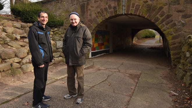 Residents Philip Plotch and Art Murray pose by Radburn's iconic tunnel on Saturday, December 12.