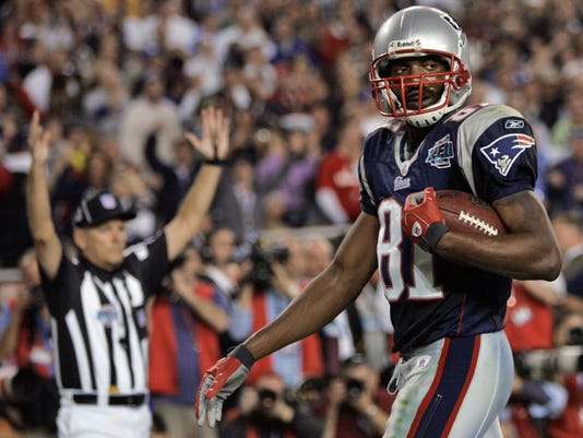FILE - In this Feb. 3, 2008, file photo, New England Patriots receiver Randy Moss reacts after a touchdown reception during the fourth quarter against the New York Giants in NFL football's Super Bowl XLII in Glendale, Ariz. The Giants won 17-14. (AP Photo/David Duprey, File)