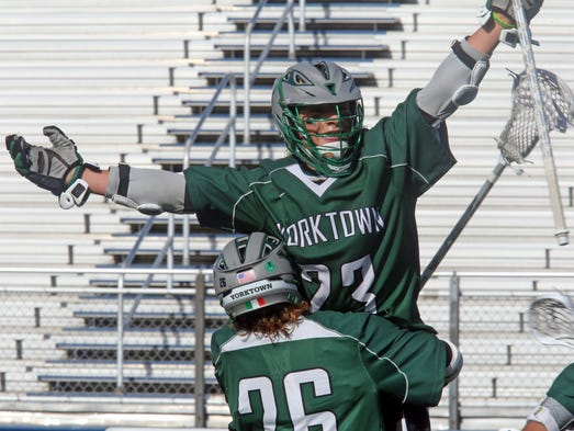Yorktown's Dom Cioffi (26) celebrates with his teammate