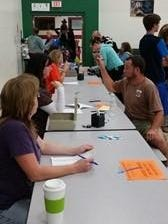 Madison School held an open house recently. Pictured are parent volunteers helping with registration.