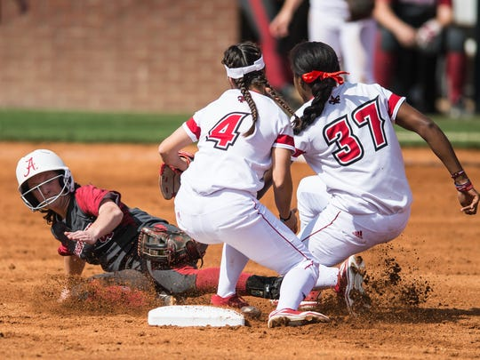 UL shortstop DJ Sanders (37) and Kassidy Zeringue (4) tag out an Alabama baserunner during the Cajuns' doubleheader split Saturday at Lamson Park.